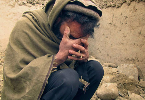 afghan mourns